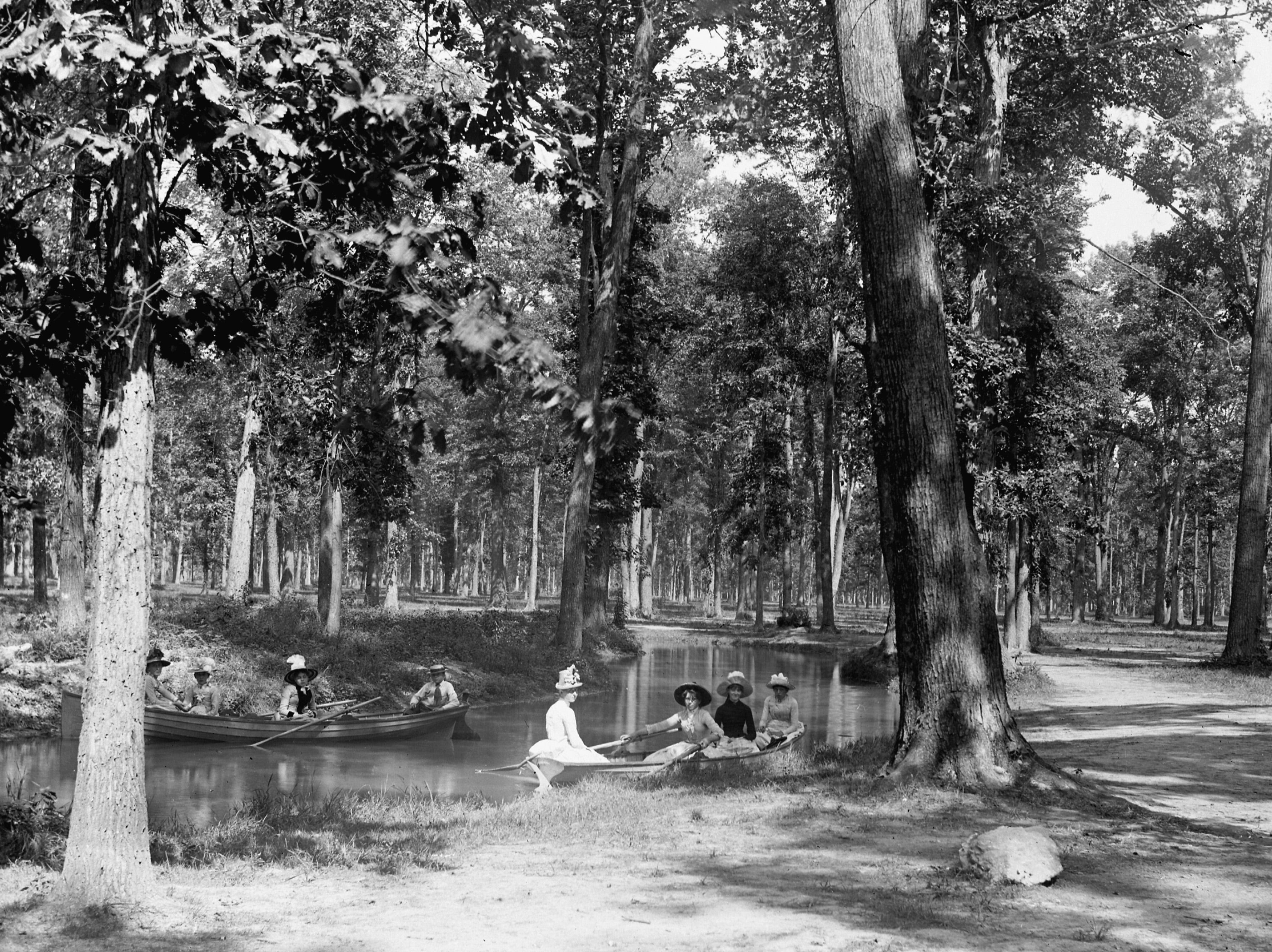 People in rowboats on the Belle Isle Park canal in the late 1800s. The park was designed in the 1880s by Frederick Law Olmstead, who also created New York City's Central Park.   See more historic photos like this in Detroit Memories Volume II: A Pictorial History of the Early Years through the 1940s. Order today at Detroit2.PictorialBook.com.