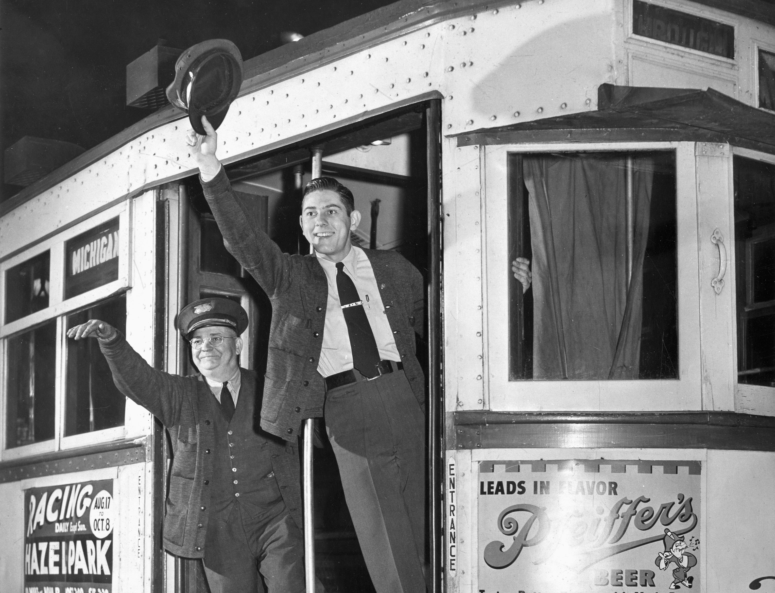 Two conductors waving from the last Department of Street Railways streetcar to leave the Baker terminal in Detroit, circa 1949. The Baker terminal was closed by Department of Street Railways and the car was shifted to the Wyoming barn.
