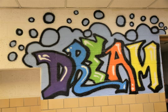 Student-created art decorates the walls at Rising Stars Academy in Center Line.