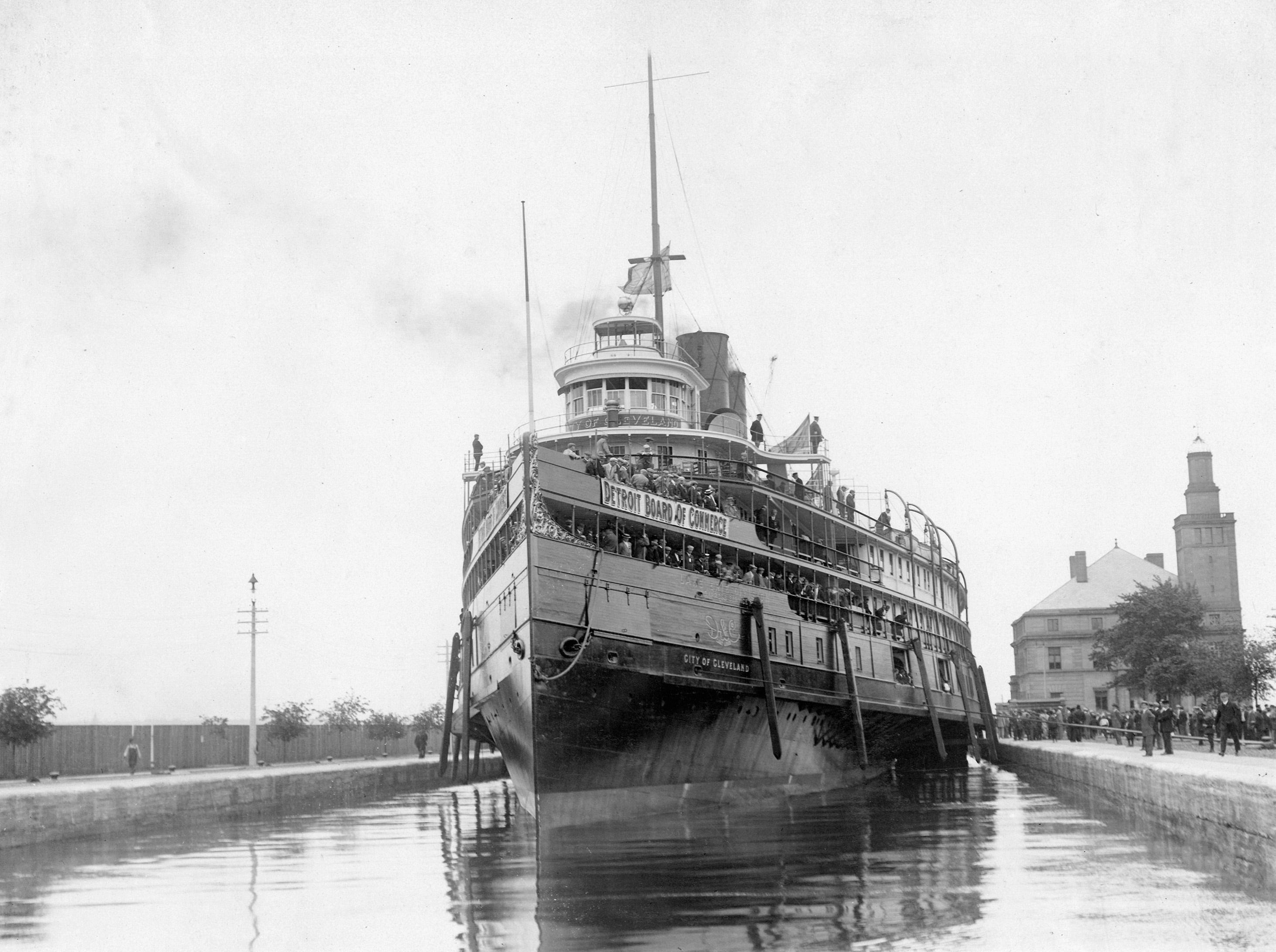 The ferry City of Cleveland traveling through Soo Locks for the Detroit Board of Commerce Convention's eighth annual cruise, 1911.