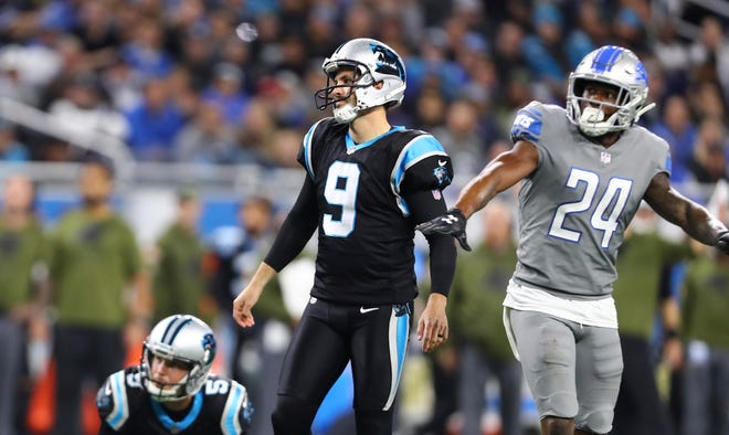 Detroit Lions cornerback Nevin Lawson waves his arms as Carolina Panthers kicker Graham Gano misses a 36-yard field-goal attempt.