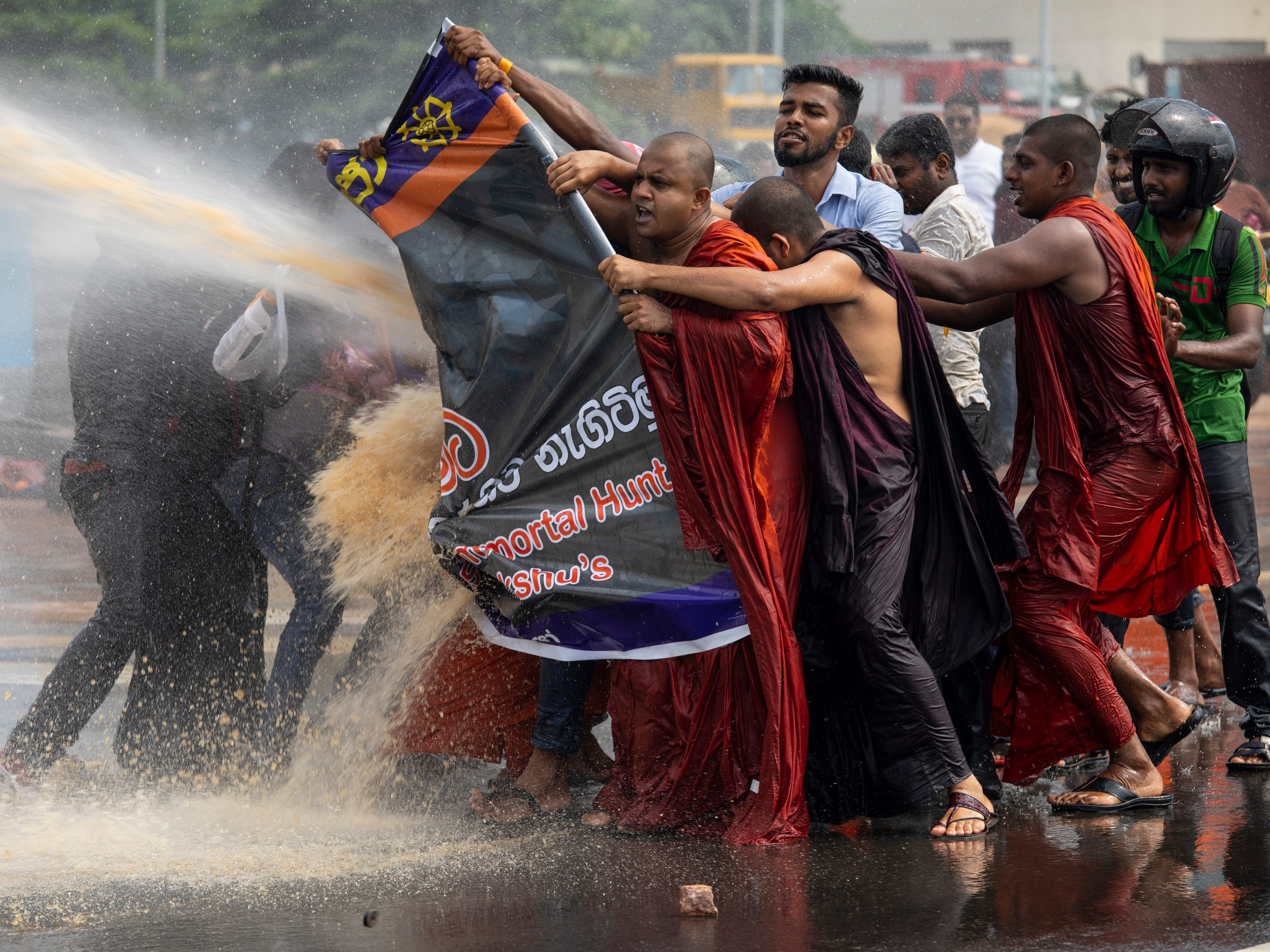 Police fire teargas and use water cannons to disperse the Sinhala extremist monks from Bodu Bala Sena (BBS) on November 19, 2018 in Colombo, Sri Lanka. The monks came to meet with Sri Lanka's president to hand over a message calling for the release of (BBS) General Secretary Ven. Galagoda Aththe Gnanasara Thera who was sentenced to six years in prison. Sri Lankas president later apologized for the severe treatment of the protesters.