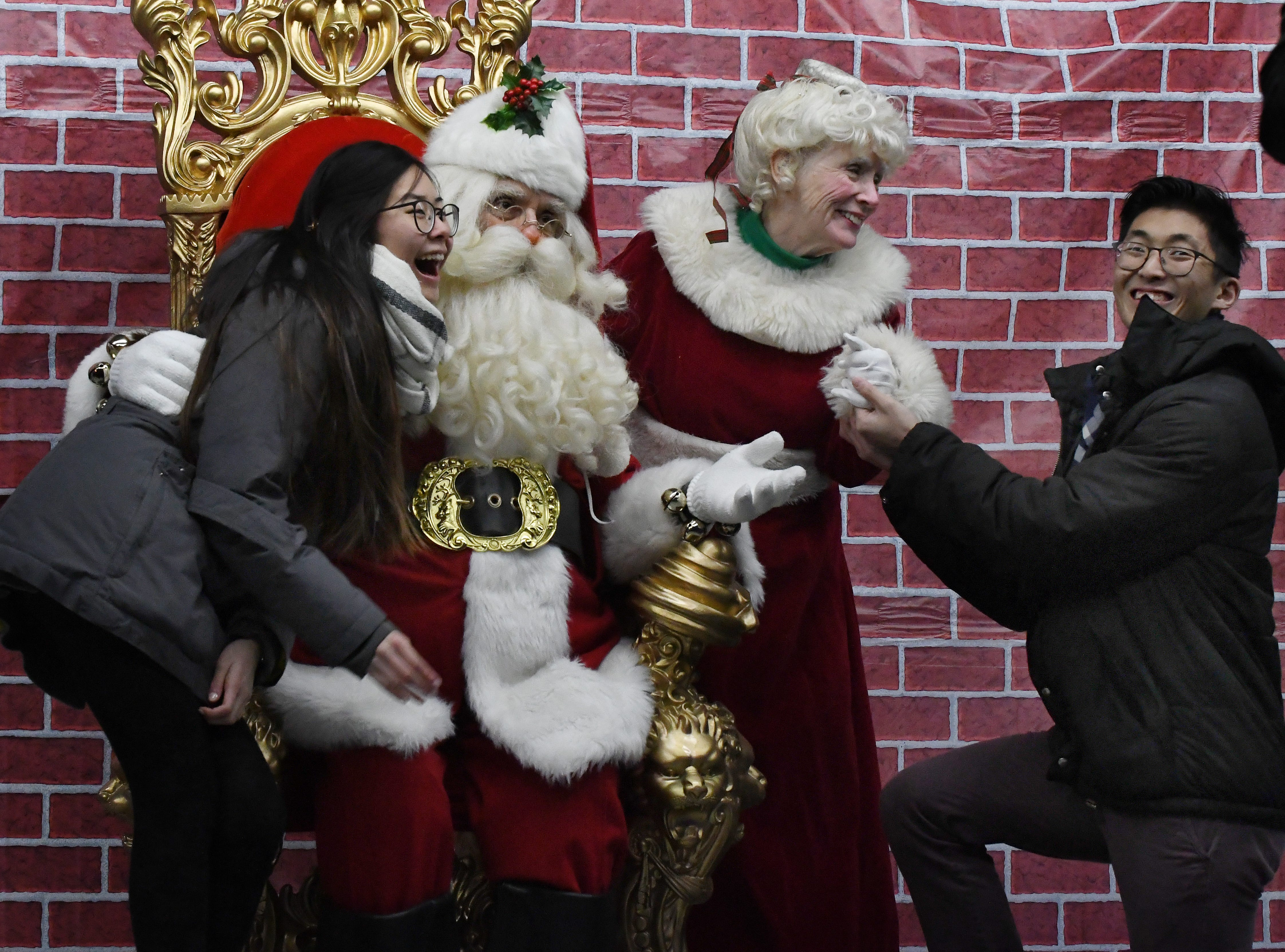 Phlevin Mei and Santa Claus are shocked as Mrs. Claus gets a surprising proposal from Brian Burton at The Big, Bright Light Show in downtown Rochester.
