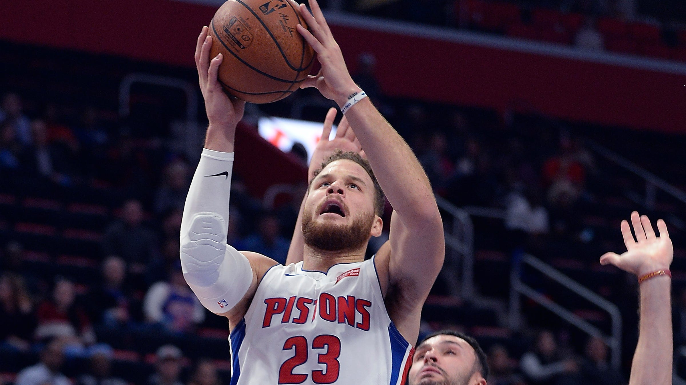 The Pistons' Blake Griffin scores over the Cavaliers' Larry Nance Jr. in the first quarter.