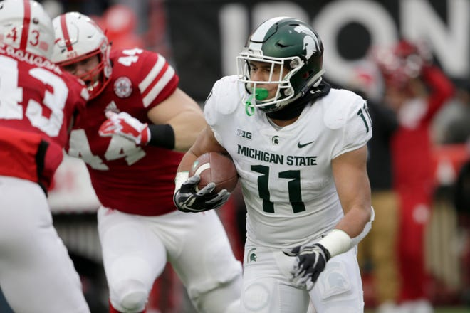 Michigan State running back Connor Heyward (11) rushed for 80 yards against Nebraska, but didn't get many rushing attempts in the fourth quarter.