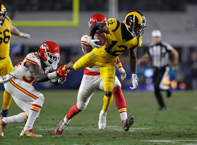 Los Angeles Rams wide receiver Brandin Cooks (12) is tripped up by Kansas City Chiefs free safety Ron Parker, left, during the second half Monday. The Rams won 54-51.