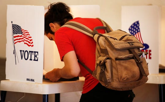 """(FILE -GENERIC) -- A voter heads to the polls in an April 2017 file image. In Maine, for the first time in U.S. history, a controversial voting system known as """"ranked choice"""" is being used to decide a federal election."""