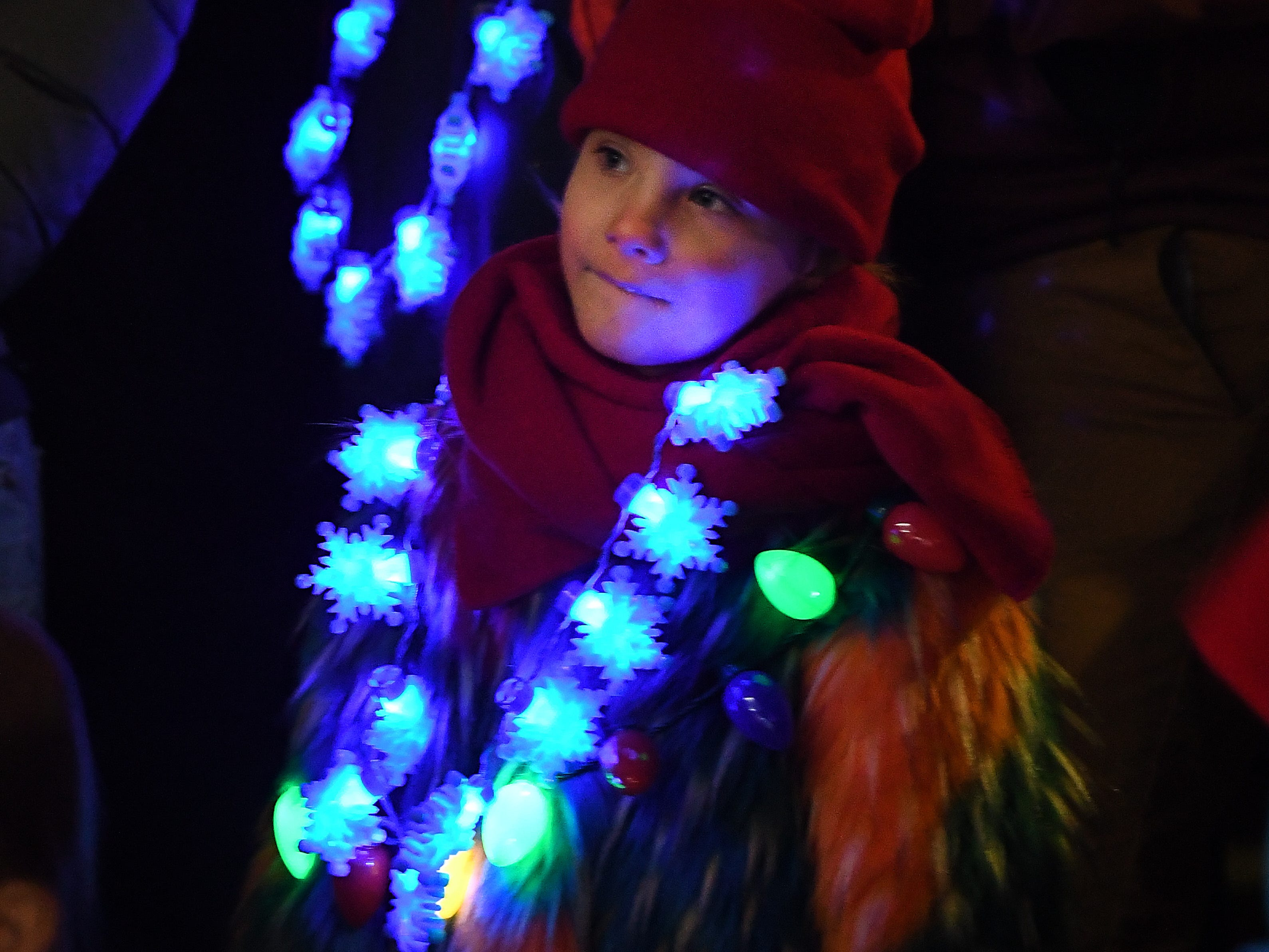 Alexis Ciucanu, 5 listens to Christmas caroling, waiting patiently for Santa Claus to arrive at The Big, Bright Light Show.