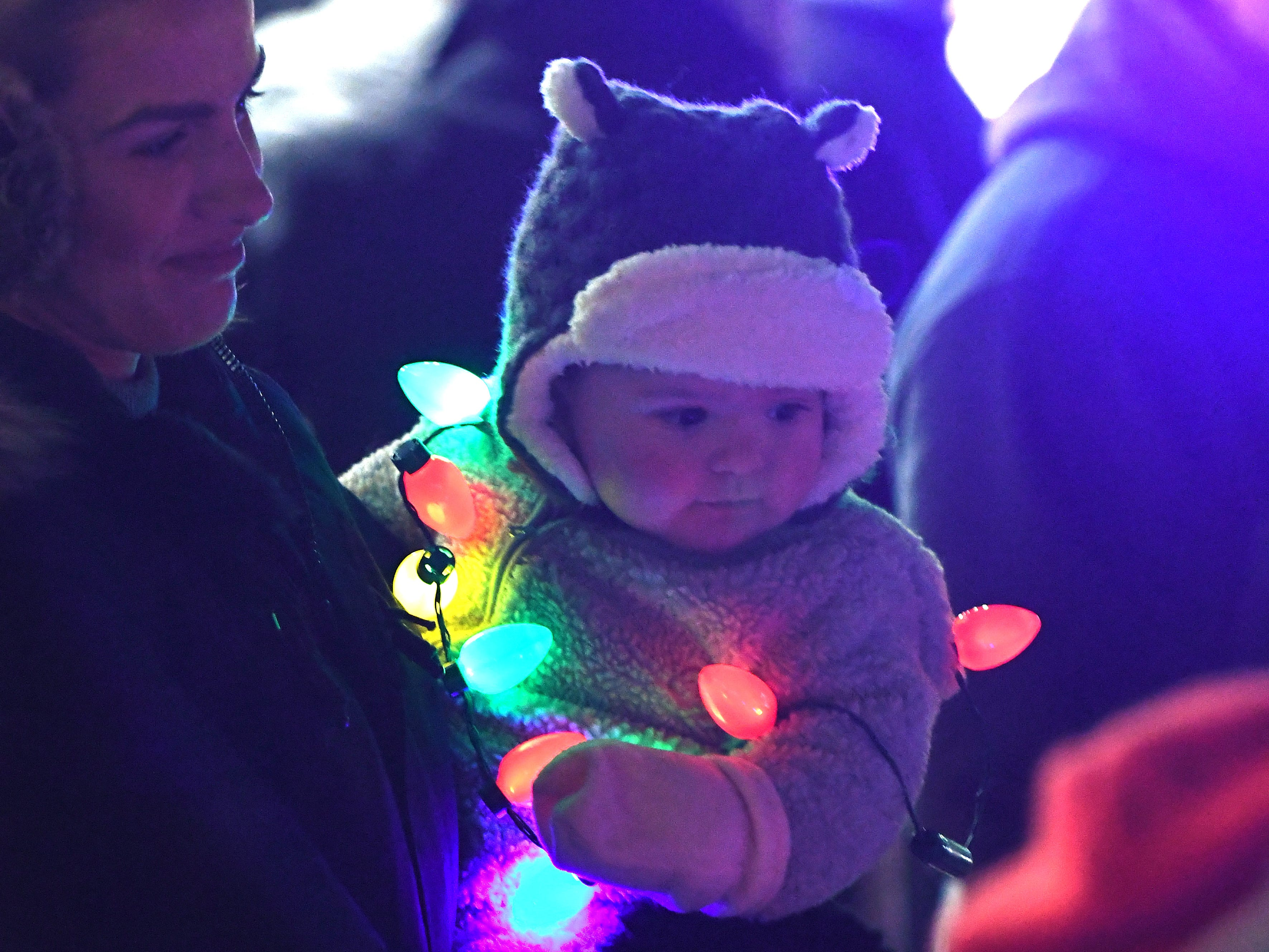 Ella Nikollaj, turning one this week, waits for the lights to come on in downtown Rochester before the debut of The Big, Bright Light Show.