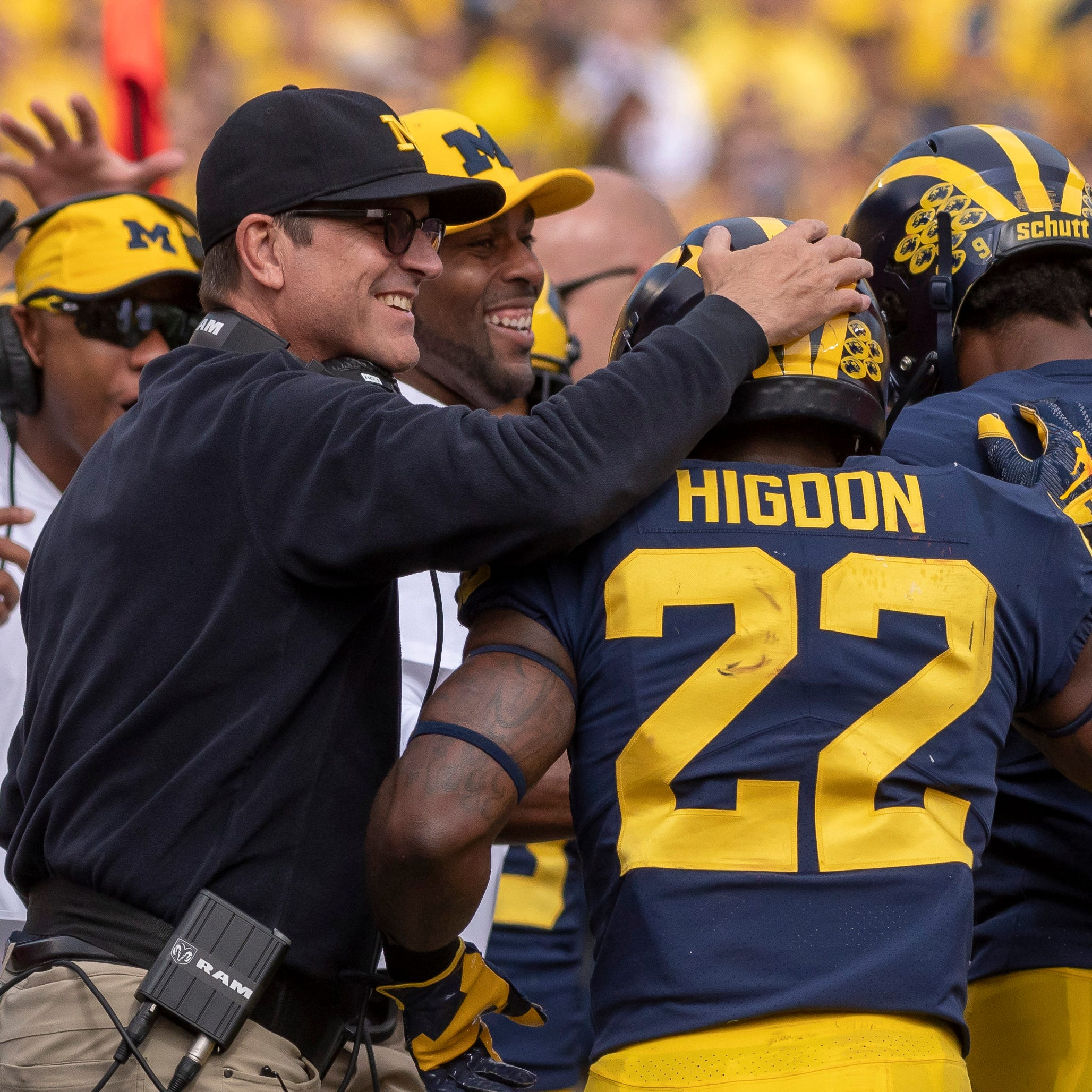 Harbaugh chides 'guarantee' question: Higdon 'confident' in Michigan
