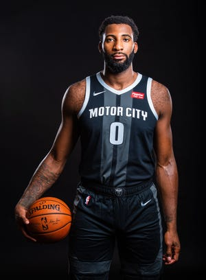 Andre Drummond models the Pistons' City Edition uniform.