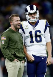 Los Angeles Rams head coach Sean McVay (left) runs one of the NFL's most potent offenses, piloted by quarterback Jared Goff (16).