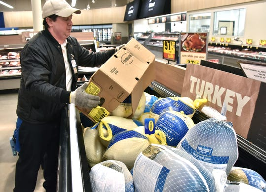 Micah Filliez, a 27-year employee of Meijer, fills a freezer at the Acme store Thursday, Nov. 15, 2018. He was filling the Butterball turkey section for the third time that morning.