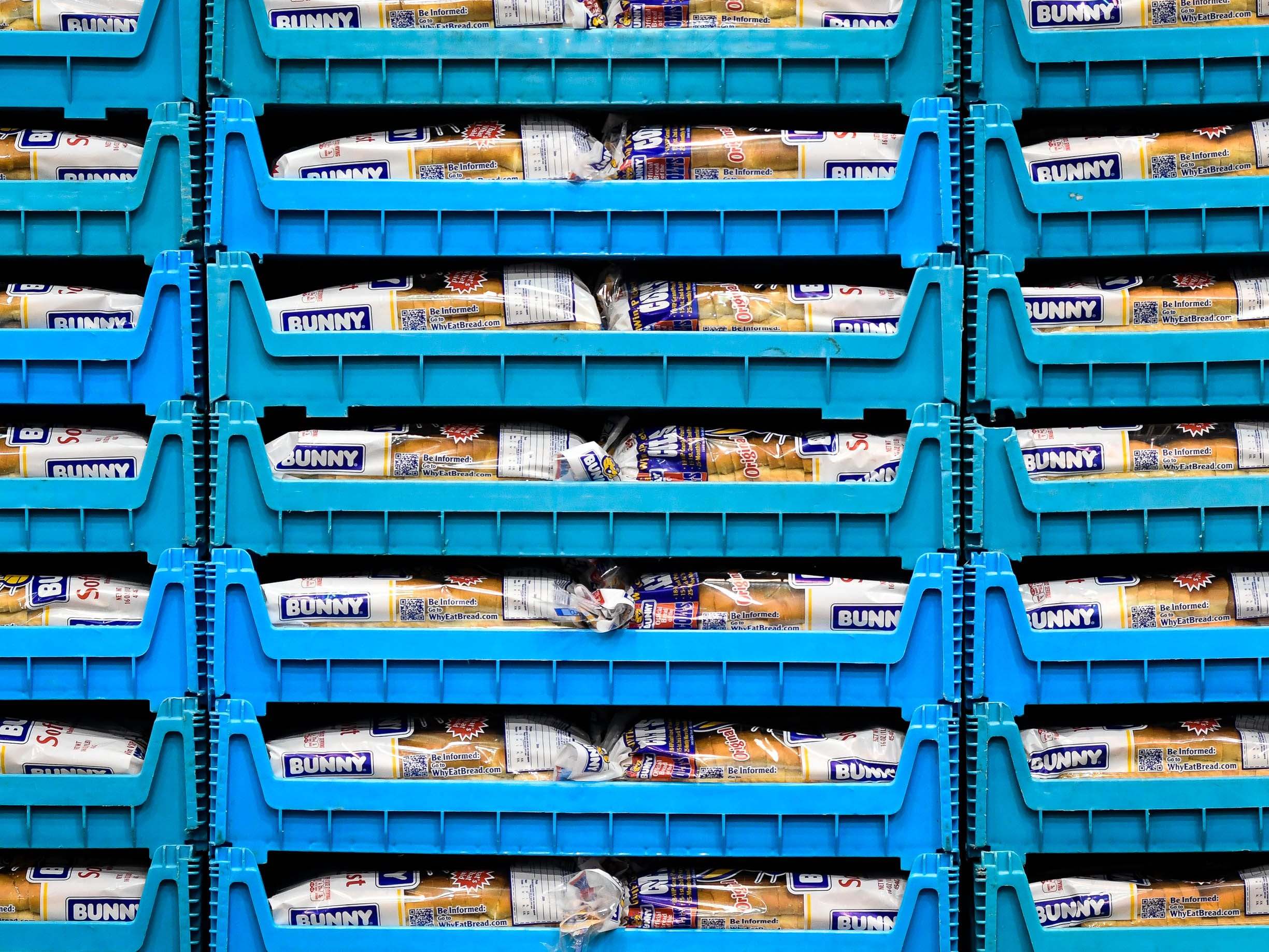 Trays of bread wait to be handed out at the Evansville Rescue Mission's 96th annual Gobbler Gathering held at the Old National Events Plaza Tuesday, November 20, 2018.