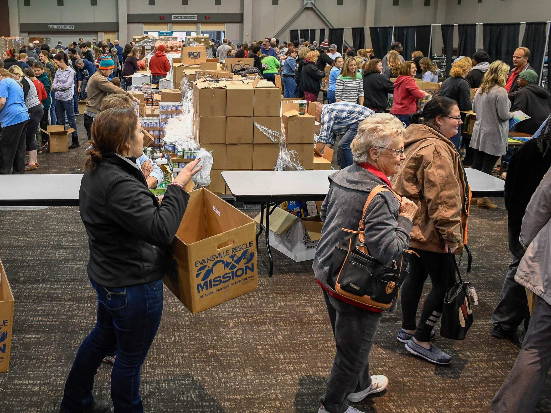 Volunteer helpers and families in need at the Evansville Rescue Mission's 96th annual Gobbler Gathering held at the Old National Events Plaza Tuesday, November 20, 2018.