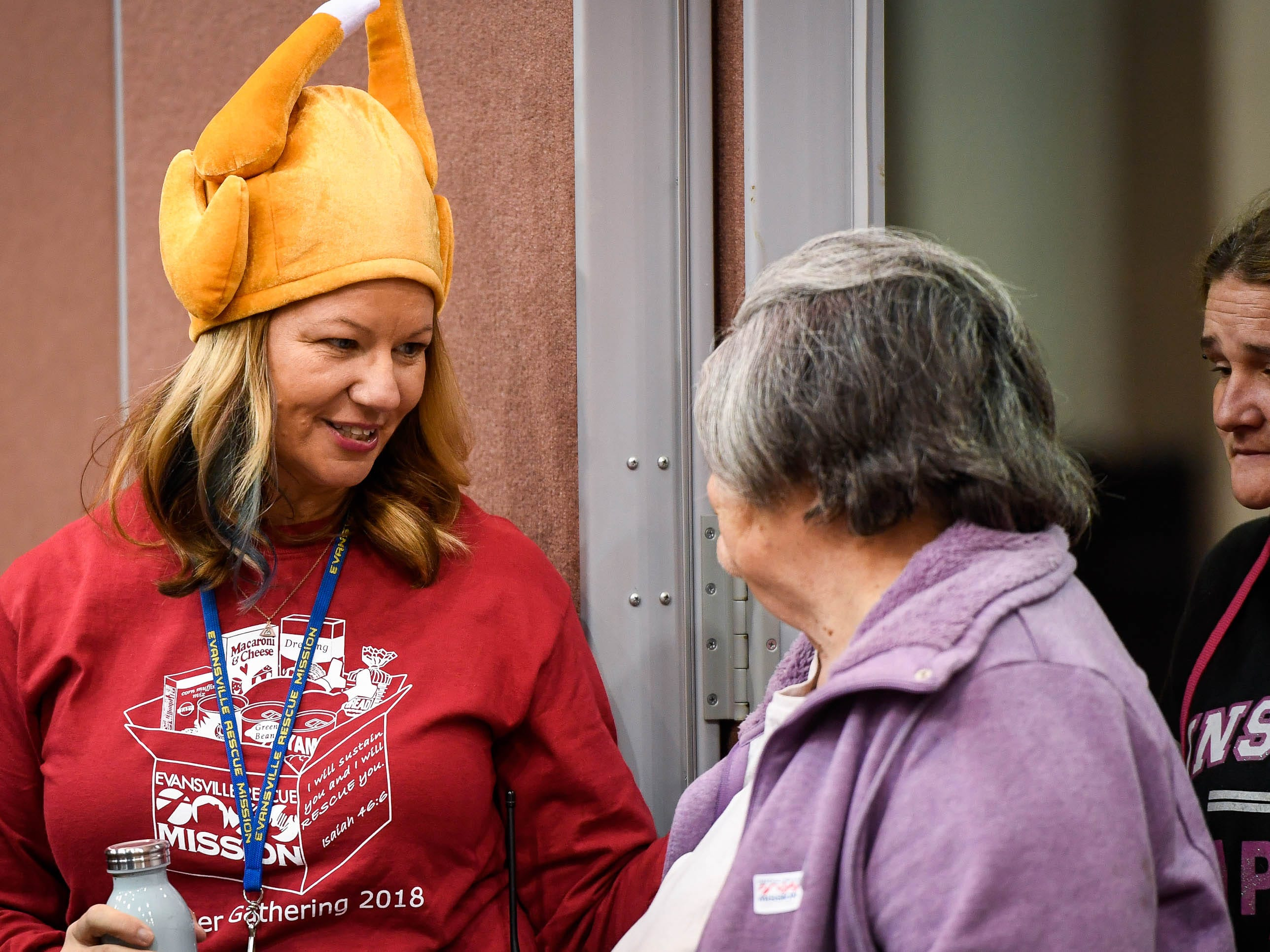 Volunteer Amanda Crowe helps families in need find a helper at the Evansville Rescue Mission's 96th annual Gobbler Gathering held at the Old National Events Plaza Tuesday, November 20, 2018.