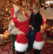 A child sits on Santa's lap during a previous Sunday with Santa at the Reitz Home Museum.