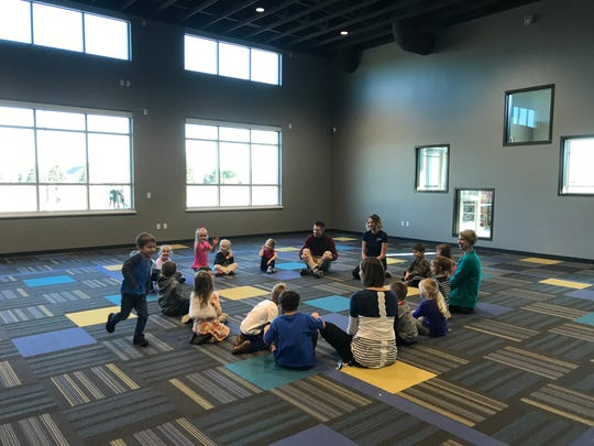 Preschool students play duck, duck, goose in the Faith Lutheran's sunrise room.