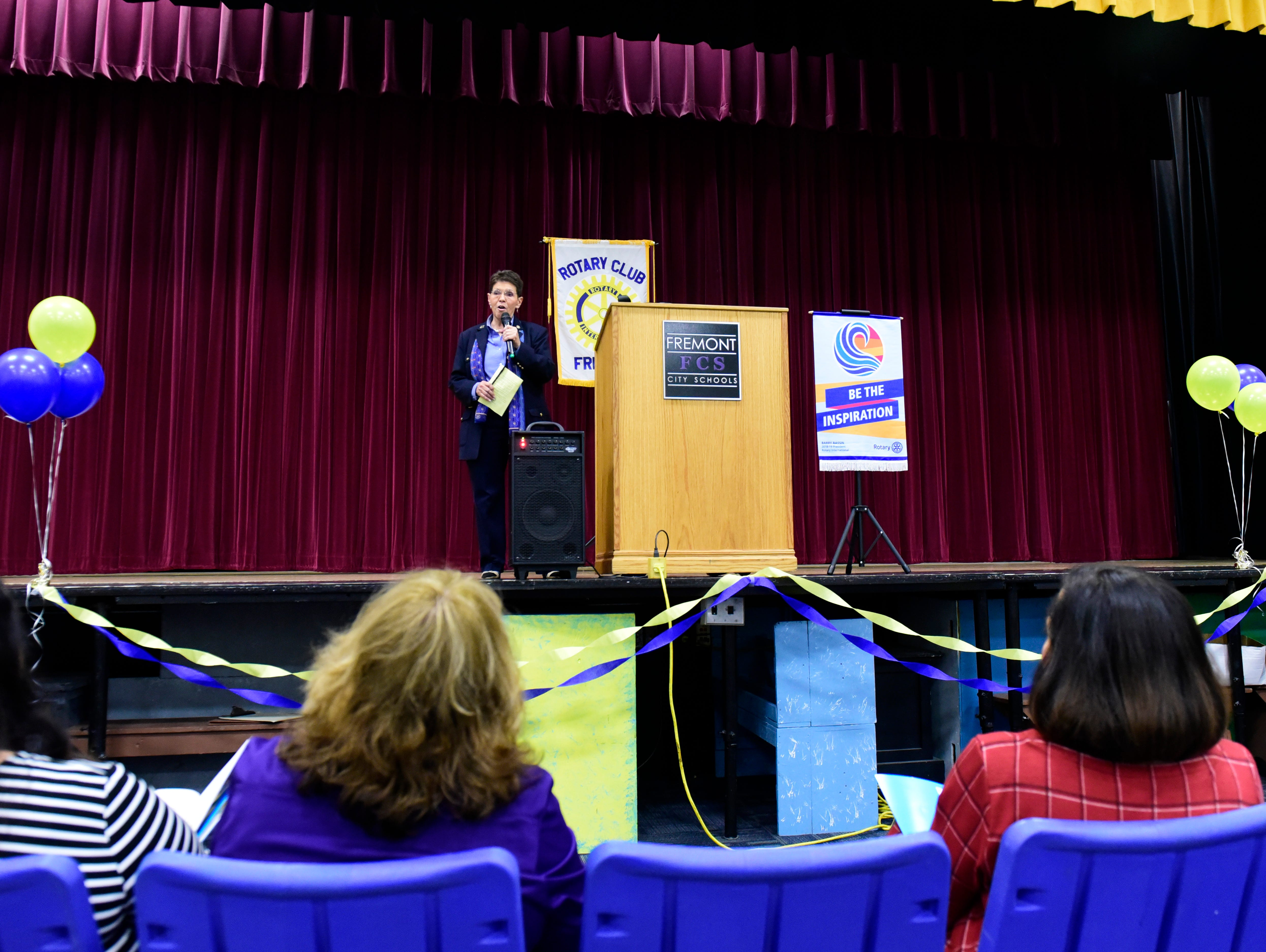 Rotary governor Maris Brenner gives the introduction at Monday night's celebration fo the launch of the Interact club at Fremont Ross High School.