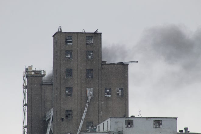 Smoke drifts from a grain elevator at Bunge North America Plant in Bellevue.
