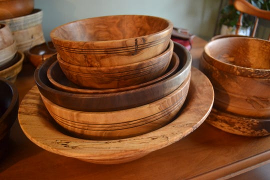 Stacks of finished wooden bowls sit in John Fulkert's kitchen. The bowls are sold at Marblehead Soap Co. and will be available at the Dec. 1 Fulkert's Craft Show.