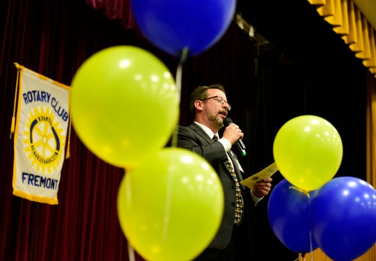 Fremont City Schools Superintendent Jon Detwiler speaks at the celebration Monday night for the launch of the Rotary-sponsored Interact club at Ross High School.