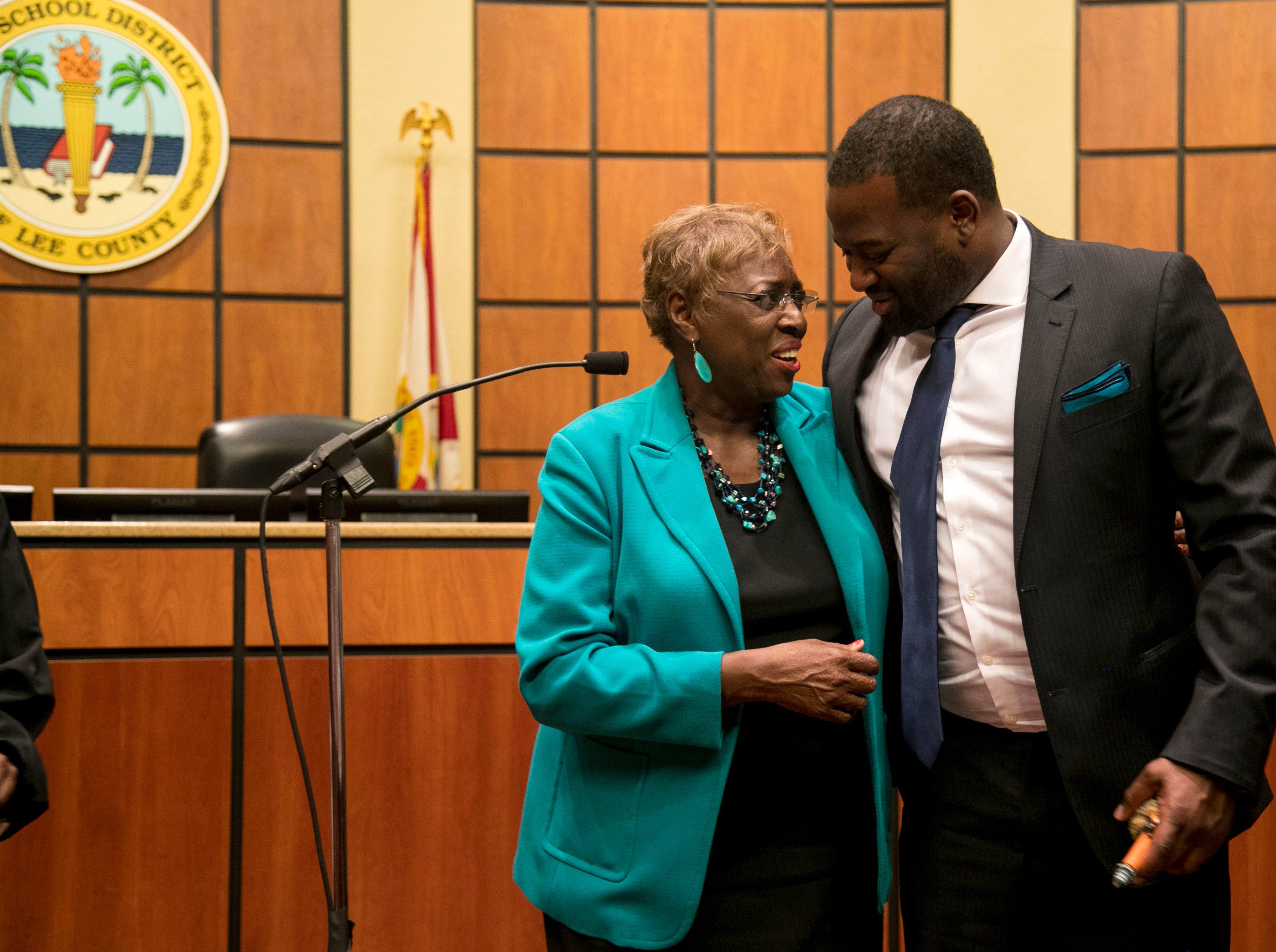 Gwyn Gittens gets a hug from her son Jonathan Sampson after taking her oath of office for the District 5 seat of the Lee County School Board on Tuesday, November 20, 2018, in Fort Myers.