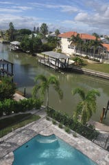 This new home on Fort Myers Beach is on a canal and across the street from the beach.