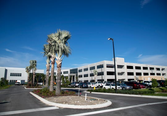 New buildings for Gartner Inc. are under construction off Chamberlin Parkway at Southwest Florida International Airport's Skyplex commerce park. More than 600 Gartner employees moved into completed structures there this month, in the first phase of the company's expansion locally.