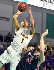 Loyola Chicago guard Lucas Williamson (1) take the ball to the rim over The Richmond Spiders forward Grant Golden (33) during the college basketball Fort Myers Tip-Off at the SunCoast Credit Union Arena, Monday, Nov. 19, 2018. (Chris Tilley Photo/)
