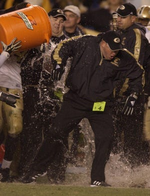 Greer head coach Travis Perry is doused as the clock winds down in the Yellow Jackets' 33-17 win over West Florence in the 2003 Class AAA state championship game at Williams-Brice Stadium.
