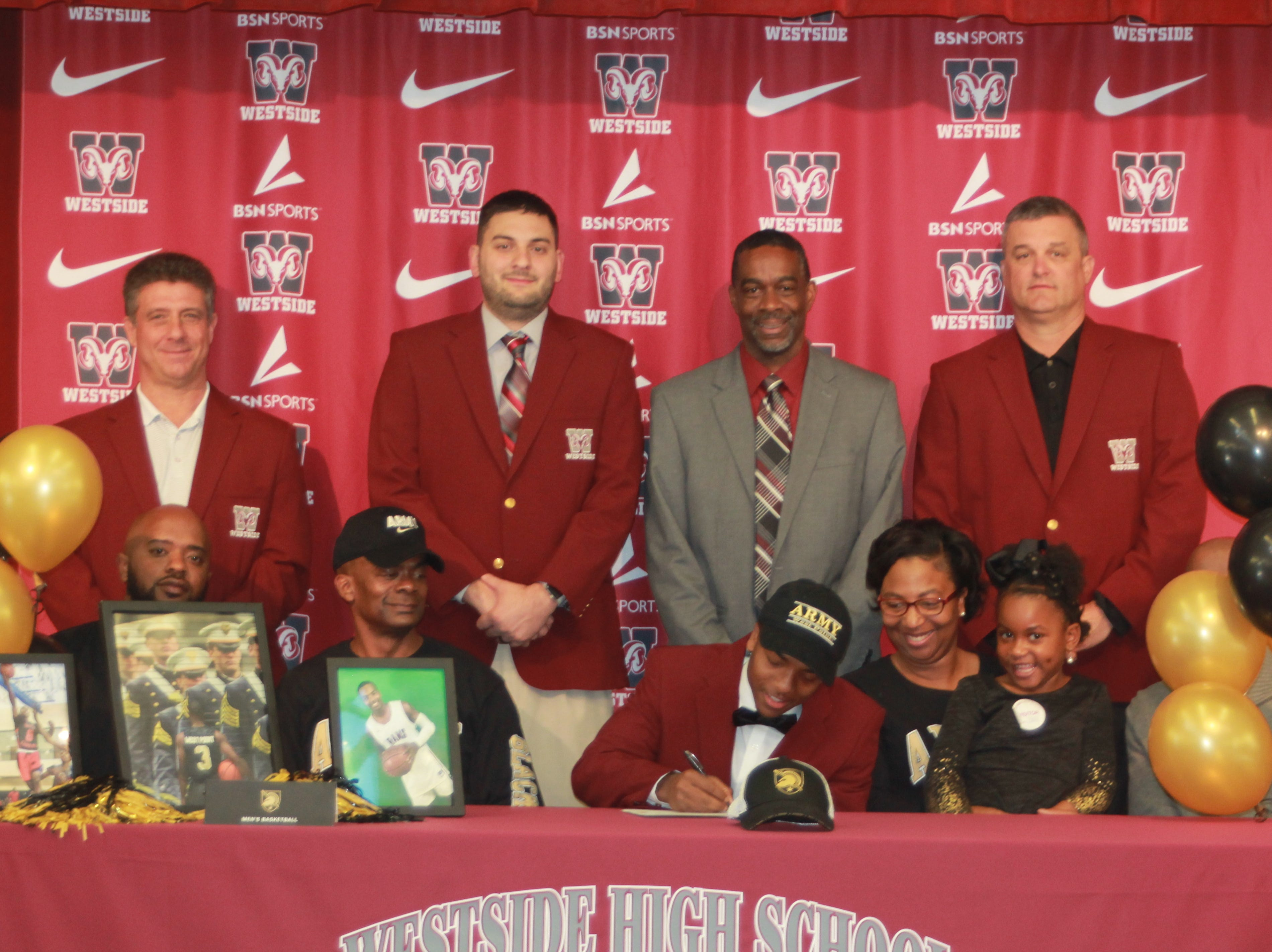 "Traye Carson, a senior at Westside High School in Anderson, signed with Army to play Division I basketball. In attendance on Tuesday, Nov. 20, 2018, were family members, current and former coaches, and his teammates. Carson is a three-sport athlete at Westside with a 4.5 GPA and is in the top 15 percent of his senior class. In his address to those in attendance, Carson thanked his current and former coaches, his family for their support, his teammates and God. He stated that, ""This is an opportunity that a lot of people don't get. I'm just ready to serve my country."" In the picture here, front row, from left: Michael Carson Jr., Michael Carson Sr., Traye Carson, Nikki Carson, Ayden-Joy Purdessy, Trenton Carson, along with his coaches."