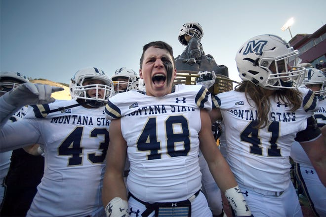The Montana State Bobcats celebrate after their 29-25 victory over the Montana Grizzlies on Nov. 17 in Missoula.