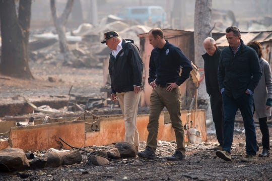 President Donald Trump,  from left, FEMA Administrator Brock Long, California Gov. Jerry Brown, Gov.-elect Gavin Newsom and Paradise Mayor Jody Jones tour the Skyway Villa Mobile Home and RV Park during Trump's Nov. 17 visit of the Camp Fire in Paradise, Calif.