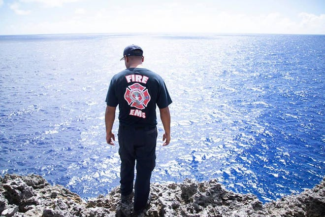 Rescue officials search for John J. Jones who went missing after diving at the Grotto in Saipan on Nov. 18, 2018.