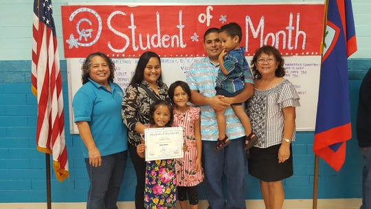Pictured front row: Isabella Pillias. Back row from left: Mary Mafnas, Dean of Elementary School Guahan Academy Charter School; Inez Pillias; Keidavonnie Pillias; Brandon Pillias with Gio Pillias and Teresita Cruz, Dean of High School Guahan Academy Charter School.