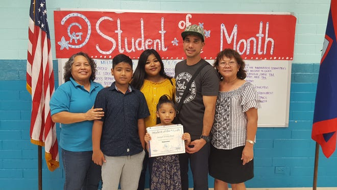 The Guahan Academy Charter School honored its September Student of the Month awardees Oct. 11. Pictured in front: Zaniyah Borja. Back row from left: Mary Mafnas, Isaiah Perez; Nadine Perez; John Borja and Teresita Cruz, Dean of High School Guahan Academy Charter School.