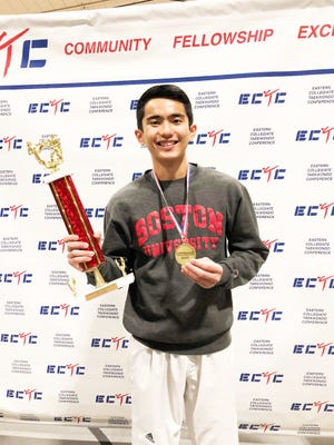 Boston University student Jed Caluag with his bronze medal and gold trophy after his participation in the Eastern Collegiate Taekwondo Conference competition Nov. 18 at Brown University.