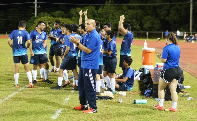 The Notre Dame Royals react to the officials' final whistle to end the game, giving the Royals their first IIAAG Boys Soccer win in more than two seasons. In a battle of winless teams, the Royals beat the GW Geckos 5-4 Nov. 19 at GW.
