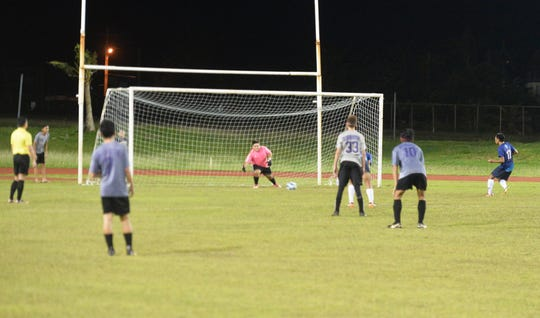 Notre Dame junior S.P. Martinez, at far right, sends a penalty kick past the GW Geckos keeper for the go-ahead goal in the Royals 5-4 win over GW in IIAAG Boys Soccer action Nov. 19 at GW.