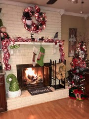 The fireplace in the home of Gabe and Raven Pirtle in Balmoral Acres is ready for Santa to make an appearance.