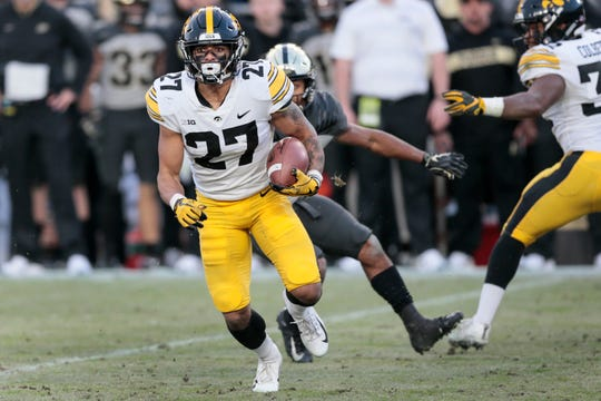 Iowa's Amani Hooker (27) ran back this interception at Purdue for a touchdown that was called back. He and Geno Stone lead the Hawkeyes with four interceptions apiece this season.