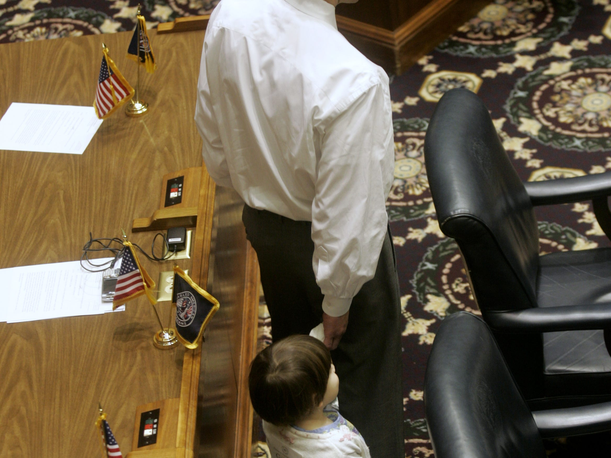 Representative David Orentlicher (cq) walks his daughter Shayna (cq) around the House chambers on organization day, Tuesday, November 21, 2006.  (Kelly Wilkinson / The Indianapolis Star)