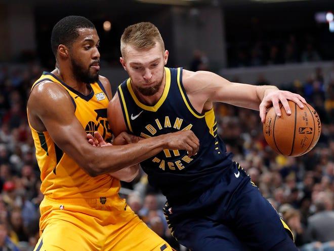 Indiana Pacers forward Domantas Sabonis (11) backs down Utah Jazz forward Derrick Favors (15) in the first half of their game on Monday, Nov. 19, 2018.