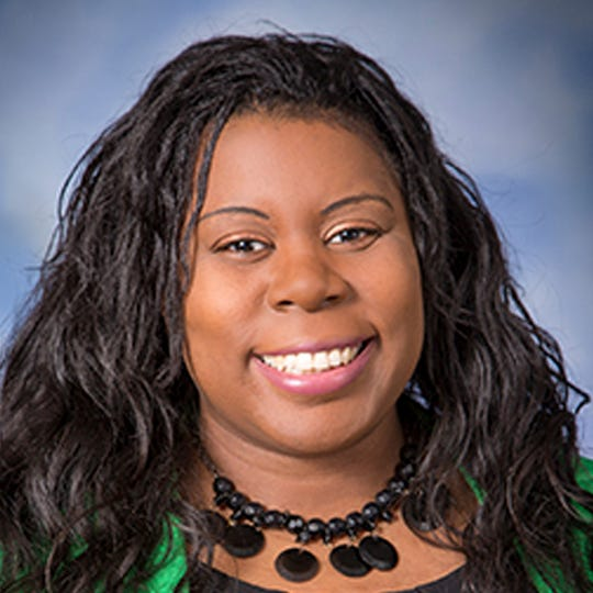 In this September 2017 photo provided by Monte Gerlach Photography Dr. Tamara O'Neal poses for a photo. O'Neal, an emergency room physician at Mercy Hospital in Chicago, was shot and killed by a gunman outside the hospital Monday, Nov. 19, 2018. (Monte Gerlach Photography via AP)