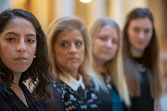 Samantha Lozano (left), and three other women have accused Indiana Attorney General Curtis Hill of inappropriate touching earlier in the year, at a press conference on the day of the start to the legislative session, Indiana Statehouse, Indianapolis, Tuesday, Nov. 20, 2018.