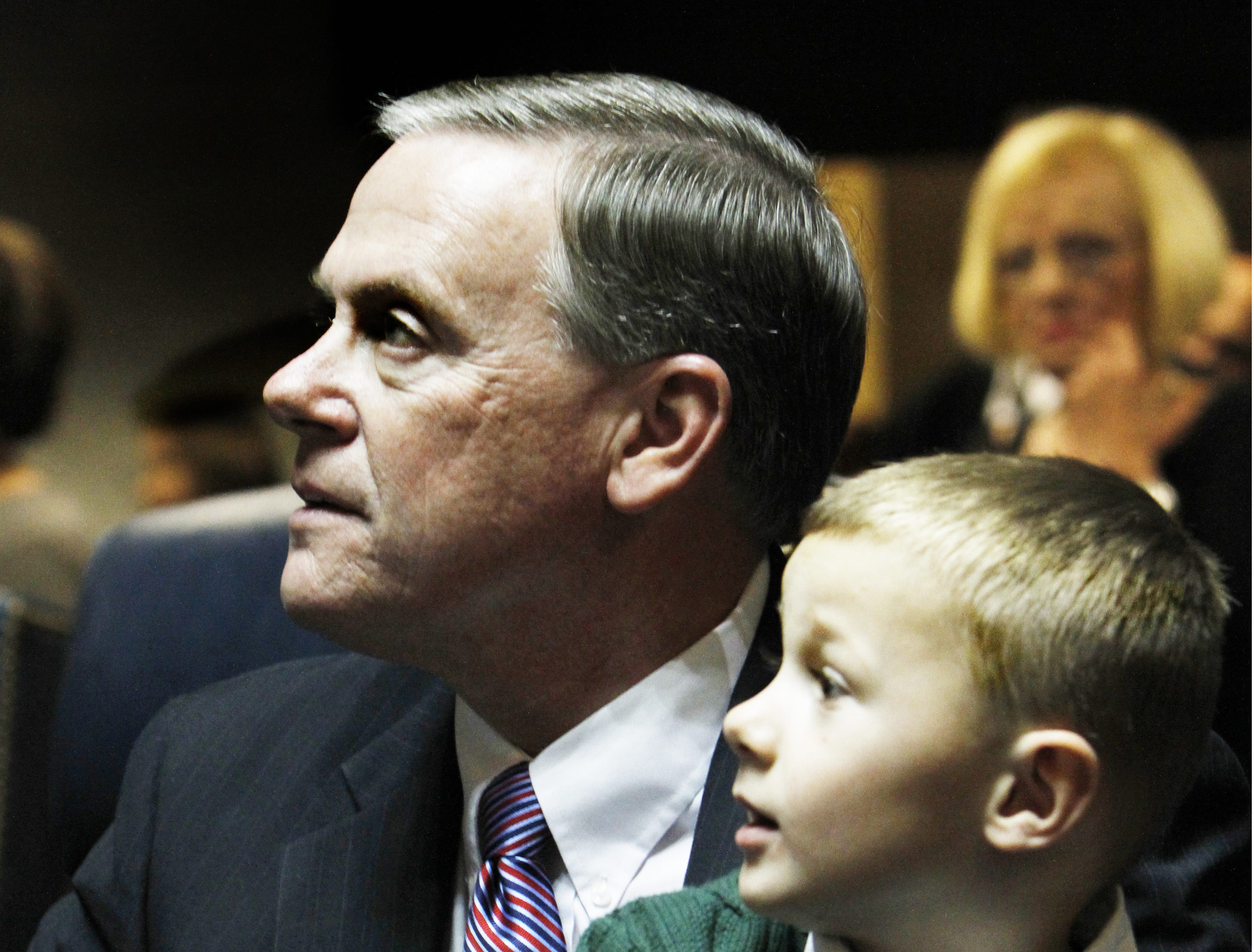 Freshman Sen. Doug Eckerty, R-Muncie, holds grandson Jayden Eschler, 5, on his lap after being sworn in during Organization Day at the Indiana Statehouse on Tuesday, November 16, 2010. Charlie Nye / The Star.