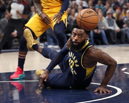 Indiana Pacers guard Tyreke Evans (12) hits the floor to chase a loose ball in the first half of their game on Monday, Nov. 19, 2018.
