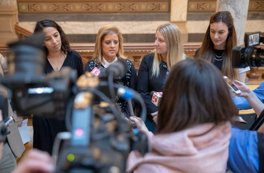 Media members talk with four women who have accused Attorney General Curtis Hill of inappropriate touching earlier in the year at a press conference on the day of the start to the legislative session, Indiana Statehouse, Indianapolis, Tuesday, Nov. 20, 2018.
