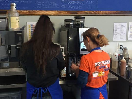 Two staff member prepare drinks  at Best Friends Coffee & Bagels in Brownsburg.
